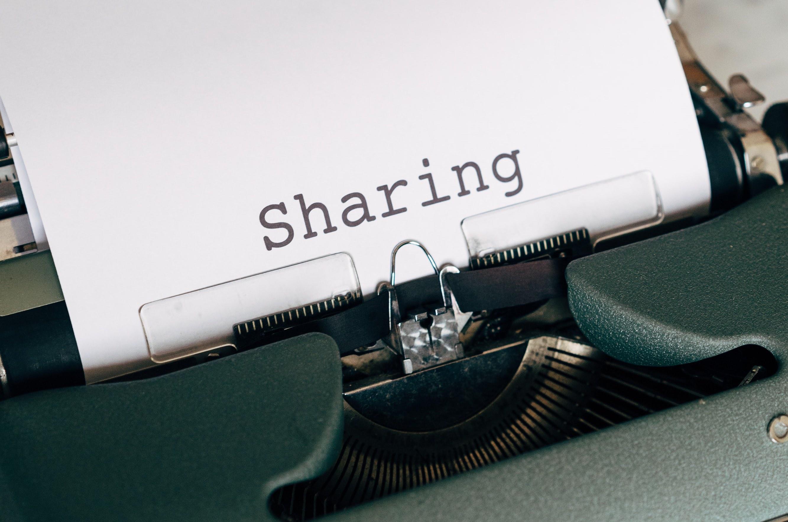 """'A typewriter typing """"Sharing""""'"""